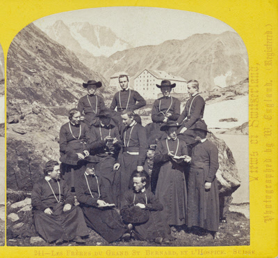 One half of a stereo view by William England. Les Freres du Grand St. Bernard et l'Hospice, Switzerland