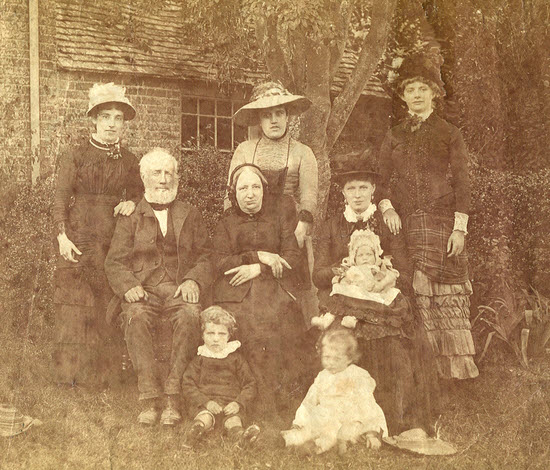 Photograph by Henry James Nobes taken about 1881/2 of his wife Helena Nobes (sitting), with three of their children and her parents. The three ladies standing at the back are probably family members