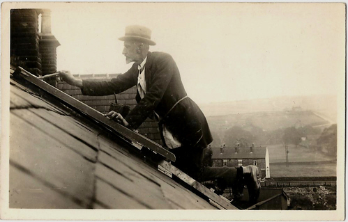 Joshua Biltcliffe mending his skylight at 8 Bridge Street, Penistone
