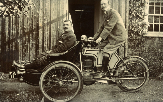 J H Wilson on his Rex tricar (new model) with Mr. T Sanderson in the front – about 1905