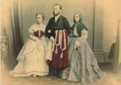 Clara Maria Cade (left) aged 18 with father Robert and mother Maria on the occasion of her first ball