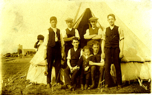 The back line is thought to be - left to right - Ernest junior, unknown, Herbert Needham, Charles. Front row - the little guy is Rupert, the other two are unknown. The church is near Llandudno. Fanny Spencer is in the background. Photo taken about 1909.